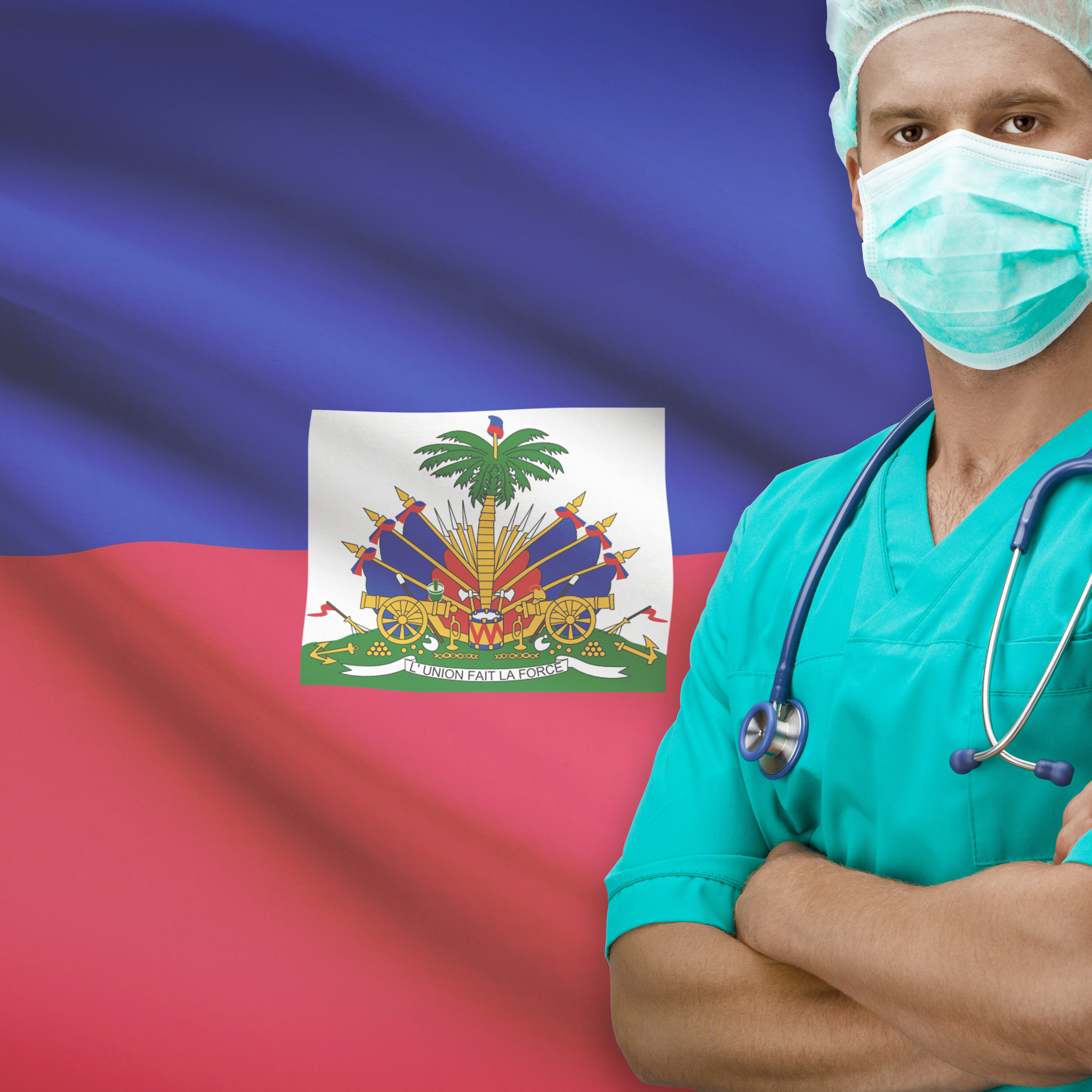 Surgeon with flag on background - Haiti